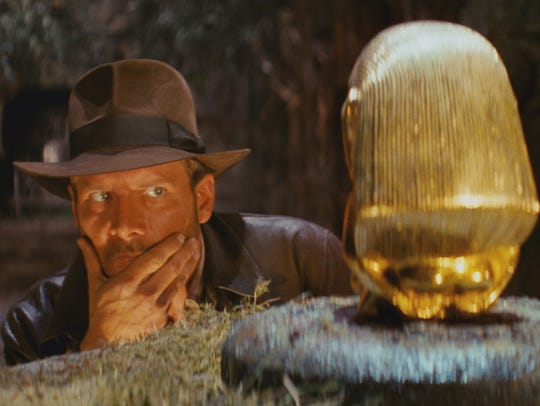 Indiana Jones (Harrison Ford) sizes up an artifact
