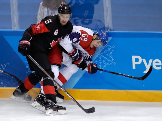 Wojtek Wolski (8), of Canada, checks Lukas Radil (69), of the Czech Republic, during the first period of the preliminary round of the men's hockey game at the 2018 Winter Olympics in Gangneung, South Korea, Saturday, Feb. 17, 2018. (AP Photo/Julio Cortez)