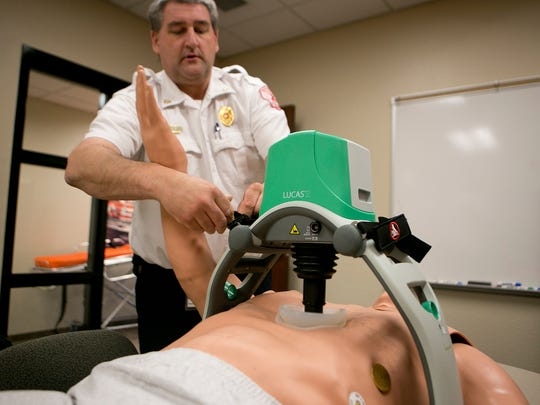 Deputy Chief Scott Owen sets up to demonstrate the Marshfield Fire Department's new LUCAS 2 Chest Compression System, which performs CPR, Wednesday, March 11, 2015.