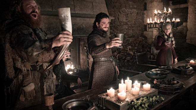 """This image released by HBO shows Kristofer Hivju, from left, Kit Harington and Emilia Clarke in a scene from """"Game of Thrones."""""""