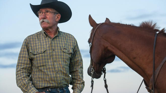 Texas cowboy Joel Nelson, recipient of the 2020 Working Cowboy Award, stands with his horse  Stoney on the Anchor Ranch in the Davis Mountains near Alpine. The award is given annually by the  Ranching Heritage Association, a nationwide non-profit organization supporting the programs of the  National Ranching Heritage Center at Texas Tech University in Lubbock.