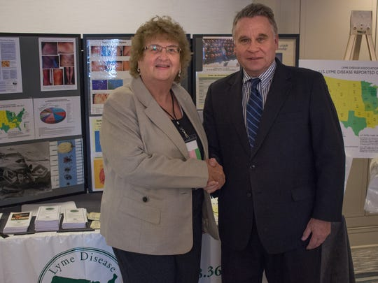 Pat Smith, left, with U.S. Rep. Chris Smith, whose legislation helped create the Lyme disease working group.