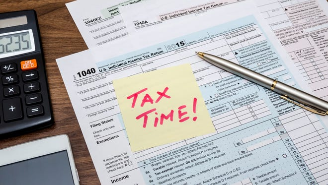 It's tax time meaning it's time to fill out tax forms using calculators, pens, and glasses.