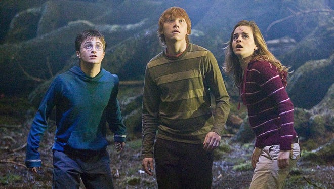 "Daniel Radcliffe, from left, Rupert Grint and Emma Watson appear in a scene from the motion picture ""Harry Potter and the Order of the Phoenix."""