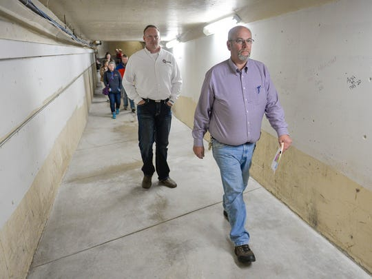 St. Cloud school district Supervisor of Buildings and Grounds Bryan Brown leads a tour of Technical High School through a tunnel that leads to some of the antiquated pipe chases Tuesday, Oct. 11, after a referendum presentation outlining the need for a new Tech and renovation at Apollo High School. Many of the school's water pipes date to 1938.