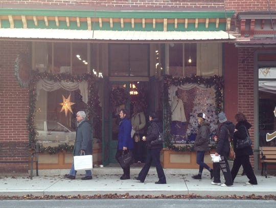 Shoppers stroll the sidewalks of Berlin for Small Business