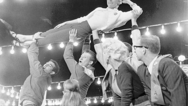Doris Day is held aloft during the ?Seven and a Half Cents? number from the 1957 movie of the Broadway musical ?The Pajama Game.? The plot centers on employees of the Sleeptite Pajama Factory asking for a seven-and-a-half cent an hour increase in pay. Day played Katherine ?Babe? Williams, their feisty employee representative. art13: Doris Day being held aloft during the ÒSeven and a Half CentsÓ number from the 1957 movie of the Broadway musical ÒThe Pajama Game.Ó The plot centers on employees of the Sleeptite Pajama Factory asking for a seven-and-a-half cent an hour increase in pay. Day plays Katherine ÒBabeÓ Williams, their feisty employee representative. Provided: Warner Brothers.