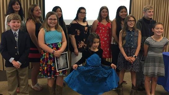 Pictured are Hunterdon County Enthusiastic Reader Award winners (front row, from left)  David Manning, Rachel Bielenberg, Xia Cobb, Jaimy Solis, Jessica Yip; (back row) author Tara Lazar, Julia Miranda, Chloe Neria, Alexandra Kemo, Katie Merriken, Sheyla Paola Aguilar, and Peter Donlon.