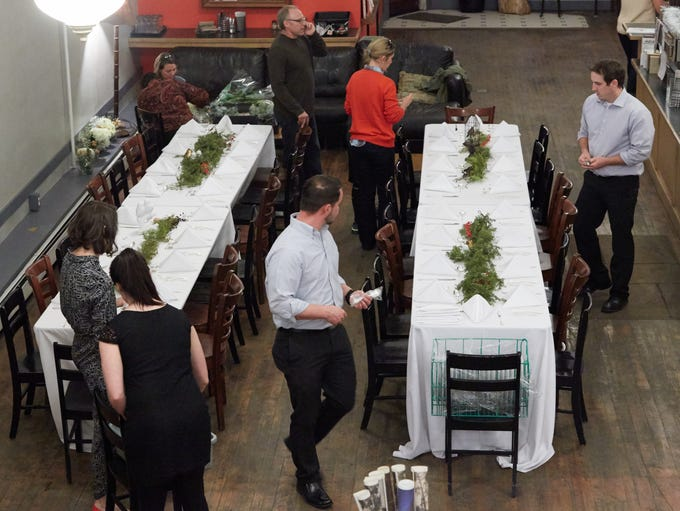 Coloradoan staff members prepare tables for January's