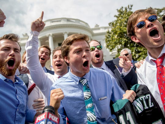 "Eagles fans sing the Eagles fight song during the ""Celebration of America"" event at the White House on Tuesday."