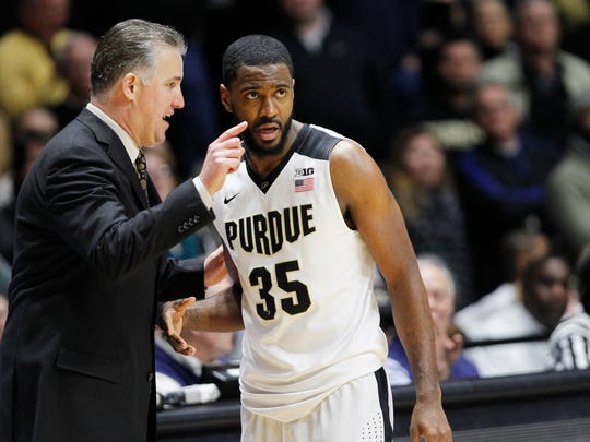 Head coach Matt Painter with instructions for Rapheal Davis as Purdue battles Michigan State Tuesday, February 9, 2016, at Mackey Arena. Purdue defeated Michigan State 82-81 OT.