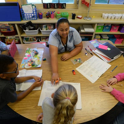 Courtney Washington teaches math to students at Fairview