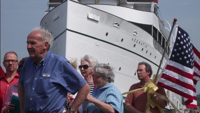 RJ Peterson, front left, at a farewell ceremony for the Keewatin passenger ship in 2012. Peterson died on Tuesday, Aug. 11, at age 93.