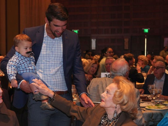 Michael Phelps and son Boomer talk with Barbara Sinatra