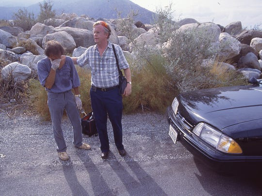Local radio broadcaster Mike Meenan (right) consoles Palm Springs Mayor Sonny Bono at the site of the Girl Scouts bus crash on Tramway Road in Palm Springs, July 31, 1991.