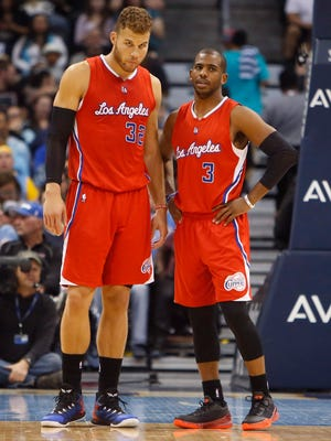Apr 4, 2015; Denver, CO, USA; Los Angeles Clippers forward Blake Griffin (32) talks with guard Chris Paul (3) during the first half against the Denver Nuggets at Pepsi Center. Mandatory Credit: Chris Humphreys-USA TODAY Sports