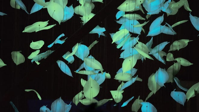 """""""Flawless"""" by Studio ALEX is made up of more than 4,000 bioluminescent leaves that glow at night. See it at Canal Convergence."""