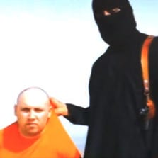 A still image from an undated video released by Islamic State militants purports to show journalist Steven Sotloff being held by the militant group.