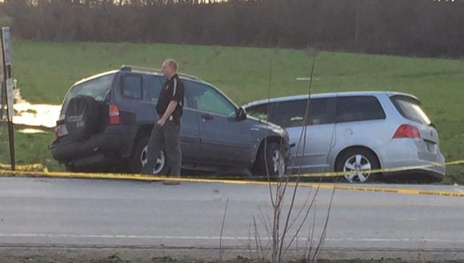 Two vehicles can be seen at the side of Indiana 421 near Monon after a high-speed pursuit of a robbery and kidnapping suspect ended in gunfire.