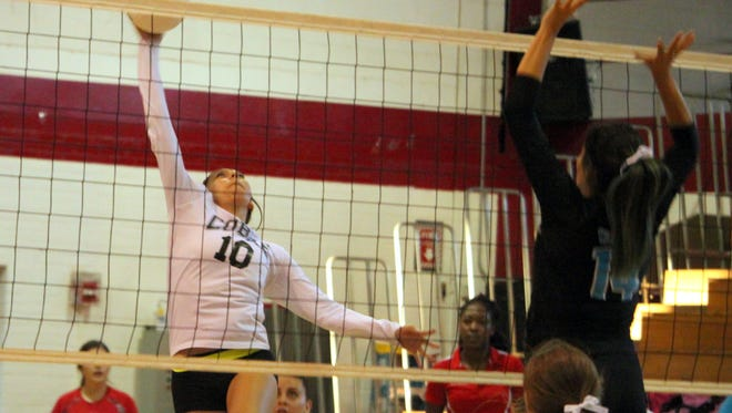 Cobre's Danielle Esqueda shoots for a kill during action against Santa Teresa. The Lady Indians would fall, 3-0, to drop just their second game of the season.