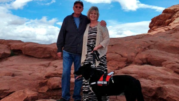 Amy and Jeff Neel with Amy's service dog, Joe, who died suddenly last month from symptoms affecting many dogs in West Side neighborhoods.