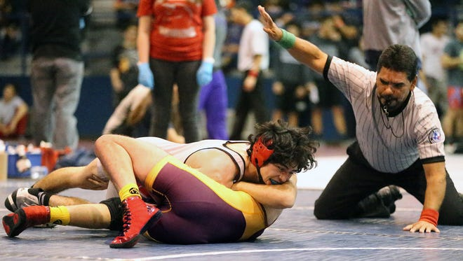 Christian Ontiveros, top, of Jefferson tangles with Kevin Chavez of Andress in the boys 120-pound class championship match Saturday at the Bowie Wrestling Tournament. Ontiveros came out on top.