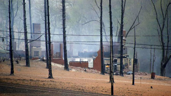 A burned out house is surrounded by charred ground and trees following a natural gas explosion Friday, April 29, 2016, in Salem Township, Pa. The explosion caused flames to shoot above nearby treetops in the largely rural area, about 30 miles east of Pittsburgh, and prompted authorities to evacuate businesses nearby. (AP Photo/Keith Srakocic)