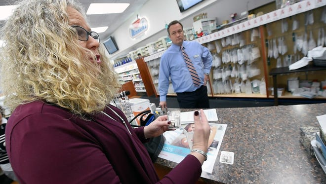Dr. Rachel Levine, state physician general, with a prescription for naloxone at  Minnich's Pharmacy in York in December. York City firefighters began carrying the antidote that can reverse the effects of an overdose this week.