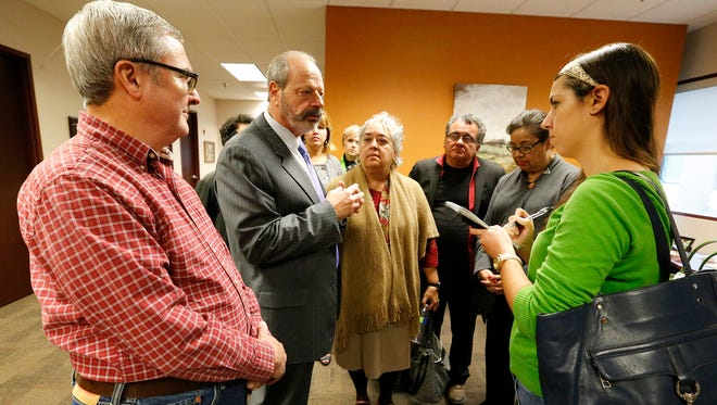 Then-Mayor Oscar Leeser gives details Dec. 16, 2016, about a meeting between civic leaders and city representatives on the location of the proposed Downtown arena. Then-city Rep. Jim Tolbert; Leeser; then-city Rep. Cortney Niland; UTEP professor Yolanda Leyva; Taylor Moreno, Leeser's assistant; Duranguito activist David Romo; and then-city Rep. Lily Limón listen as Leeser answers questions from then-El Paso Times reporter Lindsey Anderson.