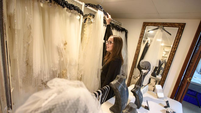 Ariel Jennifer Taub shows off some of her bridal veils at her design studio in West Bloomfield. Taub is most likely the only designer in Michigan who makes veils by hand with Swarovski crystals.