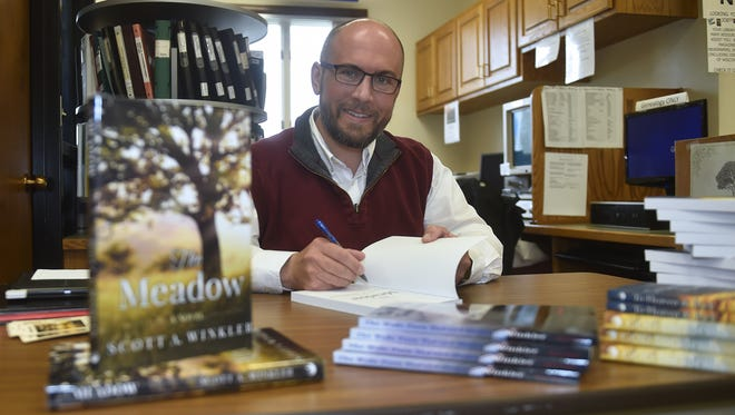 "Luxemburg-Casco teacher and author Scott A. Winkler signs copies of his new book ""The Meadow'' on May 19 at the Algoma Public Library."