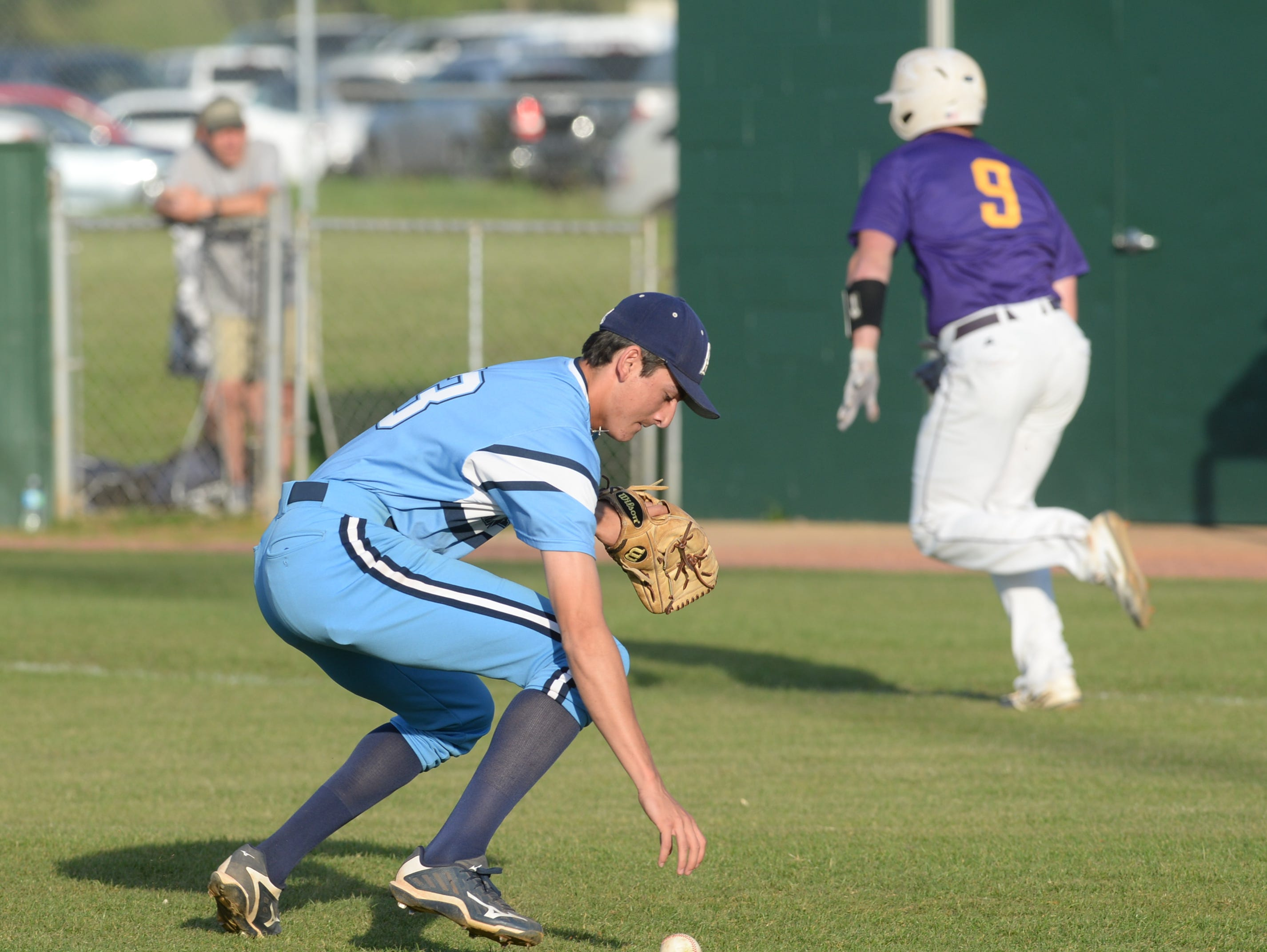 Airline pitcher Cameron Parikh can't get a handle on the ball as Steele Netterville of Byrd sprints to first.