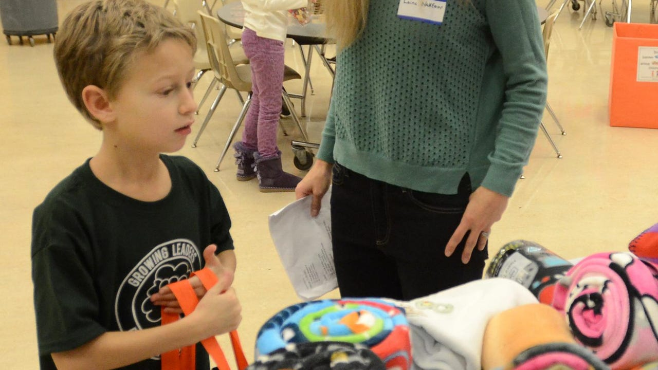 South Lyon's Active Faith distributes backpacks to needy kids from items donated by local churches, individuals and merchants.