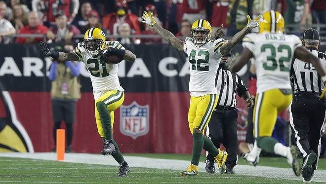 Green Bay Packers safety Ha Ha Clinton-Dix (21) reacts after making an interception against the Arizona Cardinals in the third quarter during their  NFC divisional playoff game at University of Phoenix Stadium.