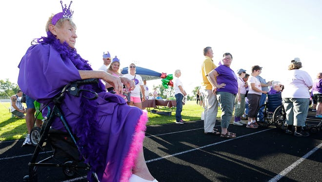 Three time cancer surviver Joan Andrew of Fond du Lac watches opening remarks for Relay For Life in Fond du Lac Friday August 5, 2016.