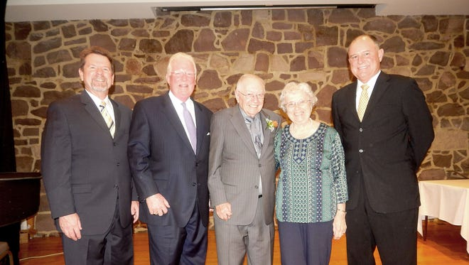 Cornwall Manor residents the Rev. Robert and Jean Stokes, center, received Cornwall Manor's 2016 Founders Day Award by, from left, the Rev. Thomas Maurer,  Cornwall Manor Board of Trustees vice chairman; Curtis Walizer, Cornwall Manor Board of Trustees chairman; and Steven Hassinger, right, Cornwall Manor president.