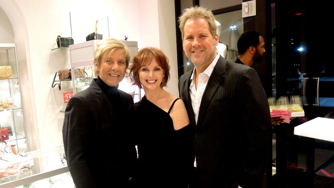 Earl Cox, Symphony Fashion Show Executive Chairman Sandra Lipman and James Mott at the Symphony Fashion Show Launch Party, held at Gus Mayer.
