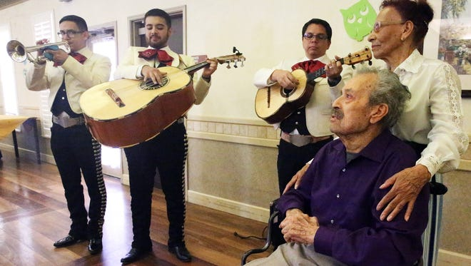 Leobardo Hernandez 89, a former El Paso Mariachi singer listens to Mariachi Estrella perform in his honor Saturday at Regent Care Center, 10880 Edgemere in East El Paso. With him is longtime friend Laura Carmona. The wish for him to sing with Mariachis once more was granted by Hospice El Paso's Senior Wish Program.