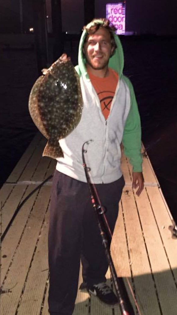 "Matthew Charles with a nice 19.75"" off a South Jersey dock at night."