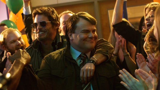 """James Marsden (with shades and cig) and Jack Black star in """"The D Train,"""" a bromance with a twist."""