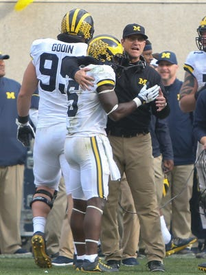 Michigan Wolverines' Jabrill Peppers and coach Jim Harbaugh celebrate late in the fourth quarter against the Michigan State Spartans on Saturday, Oct. 29, 2016 at Spartan Stadium in East Lansing.