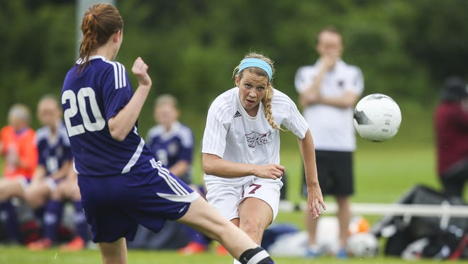 Ankeny's(17)Caroline Buelt passes the ball past Spencer's(20)Elizabeth Glover during their Class 2A first round game at the Iowa Girl's High School State Soccer Championships at Cownie Sports Complex Thursdasy June 11, 2015, in Des Moines, Iowa.