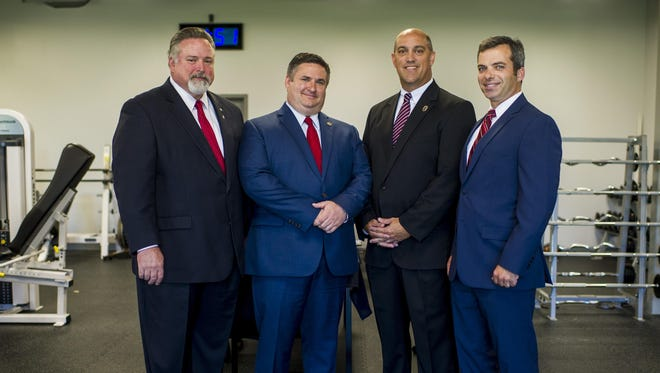 Lafayette Parish Sheriff candidates Rick Chargois, John Rogers, Chad Leger, and Mark Garber pose for a photograph during a candidate forum at the Lafayette Parish Sheriff's Office Public Safety Complex in Lafayette, LA, Thursday, Aug. 27, 2015.