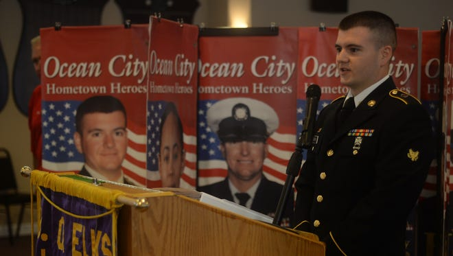 Pfc. John Adkins of the U.S. Army speaks at the banner ceremony.