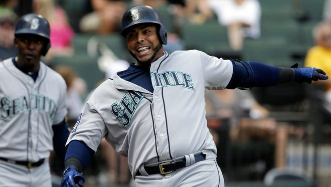 Seattle Mariners' Nelson Cruz celebrates after hitting a solo home run during the 10th inning of a baseball game against the Chicago White Sox, Sunday, July 16, 2017, in Chicago. (AP Photo/Nam Y. Huh)