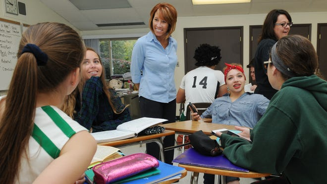 """Maureen """"Mo"""" Beck talks to students in Marcie Holloway's English class Thursday at William V. Fisher Catholic High School in Lancaster. Beck became the first alumni principal at the high school when she took over the position this school year."""