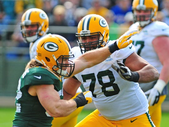 Green Bay Packers tackle Derek Sherrod works against linebacker Clay Matthews during training camp practice at Ray Nitschke Field, Monday, July 28, 2014.
