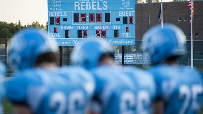 The South Burlington Rebels football team gathers on the sidelines at the start of a game against CVU in South Burlington in 2015.