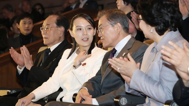 "South Koran President Moon Jae-in, third from left, talks with Kim Yo Jong, second from left, North Korean leader Kim Jong Un's sister, as they watch a performance of North Korea's Samjiyon Orchestra at National Theater in Seoul, South Korea, Sunday, Feb. 11, 2018. A rare invitation to Pyongyang for South Korea's president marked Day Two of the North Korean Kim dynasty's southern road tour, part of an accelerating diplomatic thaw that included some Korean liquor over lunch and the shared joy of watching a ""unified"" Korea team play hockey at the Olympics. At left is North Korea's nominal head of state Kim Yong Nam. (Bee Jae-man/Yonhap via AP)"