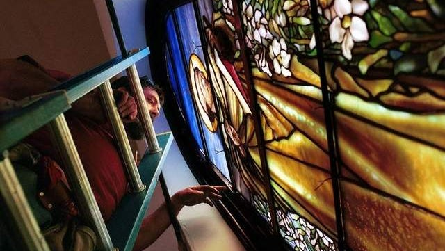 A A  Trinity Episcopal Church Purchase Image John Raynal of Raynal Studio's in Natural Bridge, installs one of the Tiffany Stained glass windows that were restored by Femenella & Assoc. of Annandale N.J. in 2001.